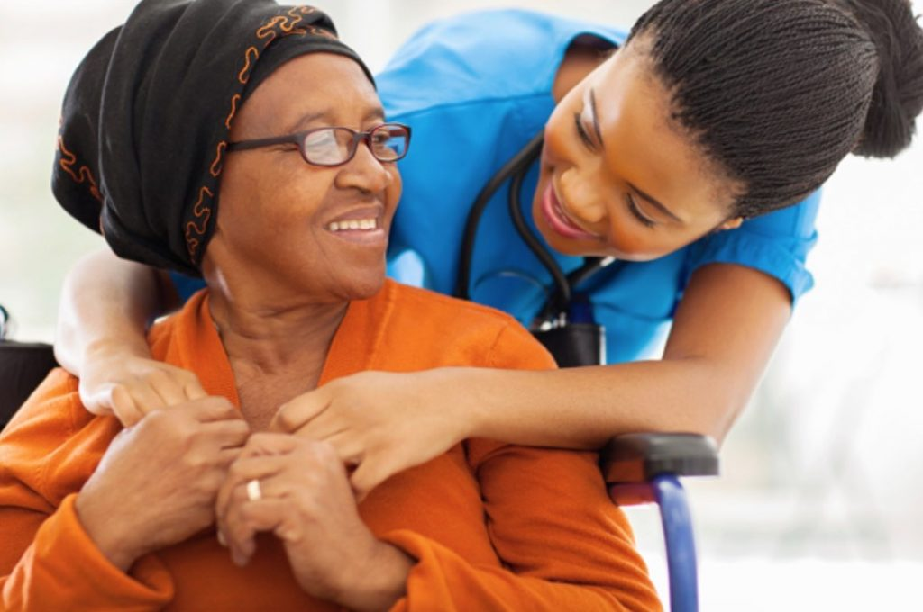 Woman and Nurse Embracing in Long Term Care Facility